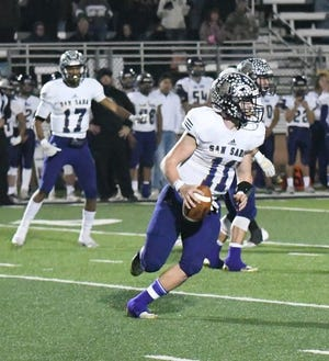 San Saba High School's Risien Shahan (11) rolls out on a pass play during a football game in 2019. Shahan was the backup quarterback in 2019 and will move into the role as starter in 2020.
