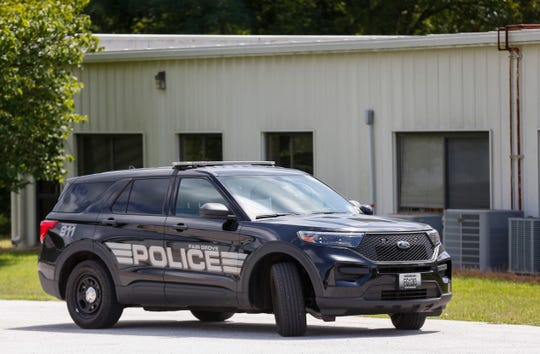 A police vehicle is parked in front of the Fair Grave Police Station on Wednesday, Aug. 5, 2020.