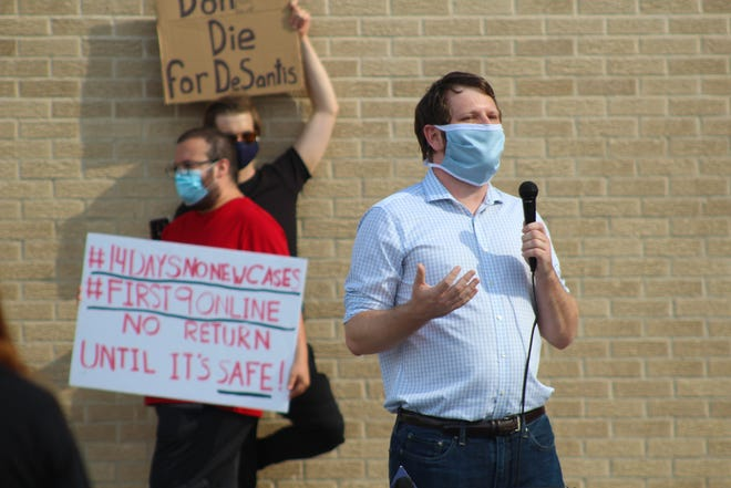Leon County Schools teachers gathered at the Aquilina Howell Center for a caravan protest against the reopening of brick-and-mortar schools amid the coronavirus. pandemic on Aug. 4, 2020.