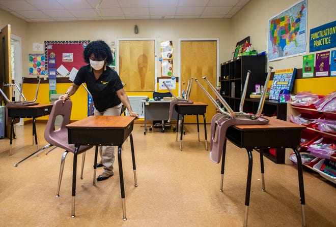 Brownsville Preparatory Institute Academic Director and teacher Bridgette McCloud sets up a classroom Tuesday, Aug. 4, 2020.