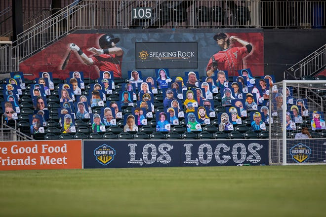 """""""Cutout Conductors"""" keep social distance behind the goal at Southwest University Park before a recent game"""