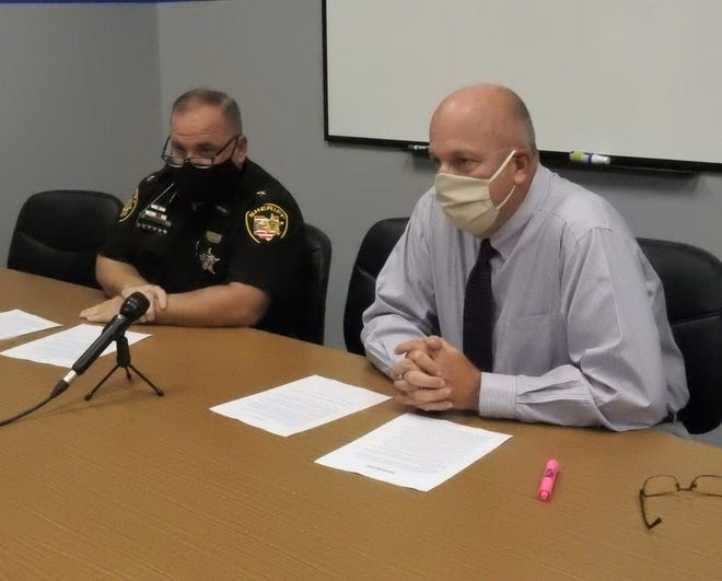 Muskingum County Sheriff Matt Lutz and Chief Tony Coury of the Zanesville Police Department conduct a press conference where they discussed two Somerset individuals being arrested related to an elaborate scheme to murder and rob local drug dealers.
