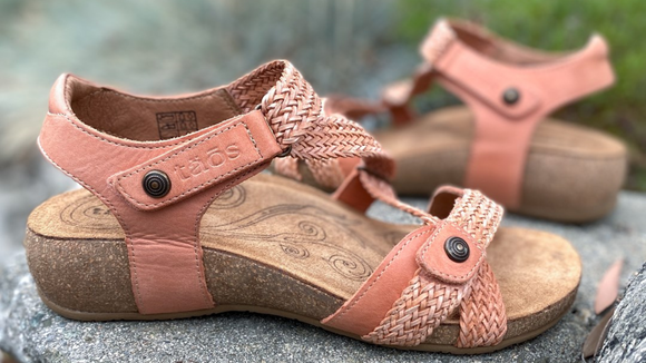 The woven leather straps add texture and style points.