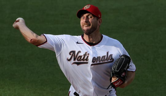 Max Scherzer pitches against the New York Mets in the first inning at Nationals Park.