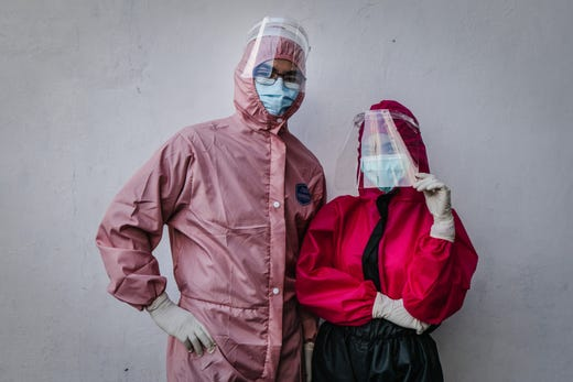 Doctors, (L-R) Yohanes Ridora and Nabila Kirtti pose for a photograph during the virtual fashion show of personal protective equipment (PPE) amid the Coronavirus pandemic on Aug. 1, 2020 in Yogyakarta, Indonesia. The fashion show was held as a form of gratitude for all medical personnel who had fought against COVID-19. Indonesia is struggling to contain hundreds of new daily cases of coronavirus amid easing of rules to allow economic activity to resume, over 100,000 coronavirus cases have been recorded and more than 5,100 fatalities.