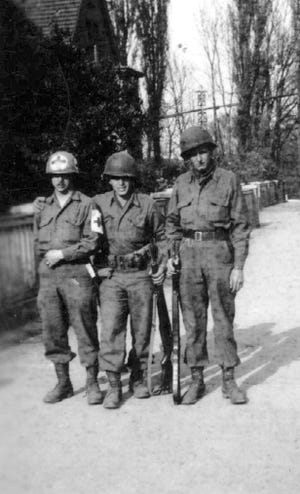 Glen Vandivier, left, served as a medic in the U.S. Army. He is pictured with fellow soldiers in 1945 in Germany. [CONTRIBUTED PHOTO]