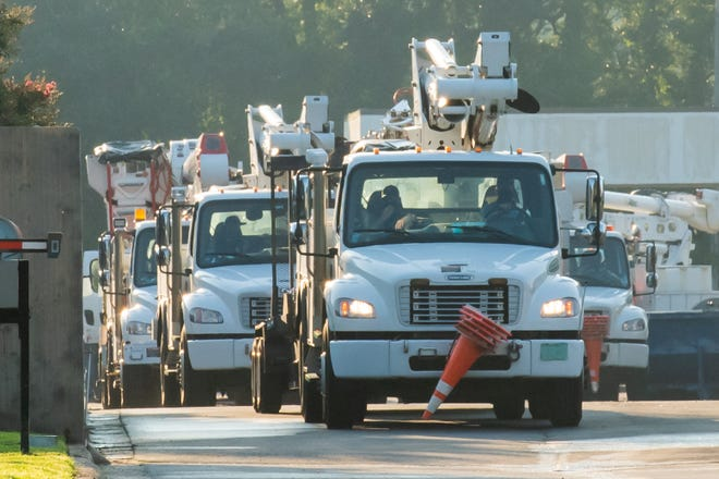 Gulf Power crews leave to help restoration efforts before Hurricane Isaias Aug. 5, 2020 in Pensacola, Florida. [MARK TELHIARD | CONTRIBUTED PHOTO]