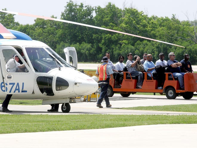 Oilfield workers arrive at the Bristow heliport in Galliano in July 2010 after Tropical Storm Bonnie prompted an evacuation of oil platforms in the Gulf of Mexico. [The Courier and Daily Comet/File]