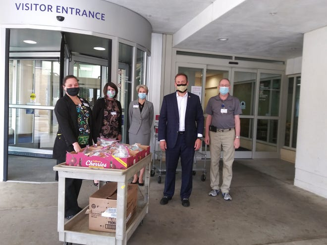 US Congressman Ted Budd (second from right) delivered boxes of care packages to be distributed to staff. The Republican represents the 13th District.