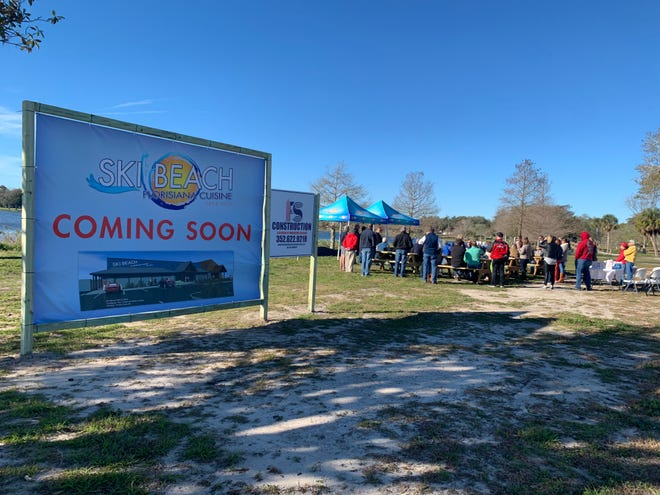 Dozens attended the Ski Beach Bar & Grill dedication ceremony in February at Venetian Gardens. [Katie Sartoris / Daily Commercial]