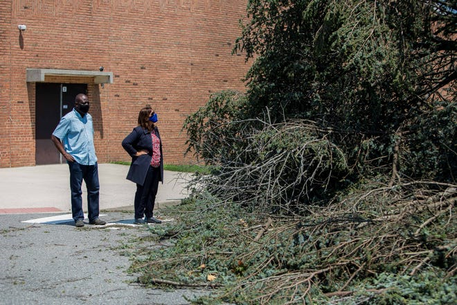 File photo after Tropical Storm Isaias hit Dover Aug. 4. Sylvia Henderson, interim superintendent for Capital School District, and Ade Kuforiji, interim assistant superintendent, looked at a huge tree that toppled over in front of William Henry Middle School in Dover. Kuforiji gave an update on the school during the Aug. 19 board meeting.