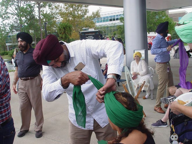 At Wear a Turban Day 2019 at the University of North Florida, members of the Sikh Society of North East Florida introduce students and other people to the head covering and its meaning. [Provided by the Sikh Society of North East Florida]