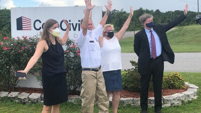 Dennis Perry (second from) waves after his late July release from prison with supporters and his legal team. [First Coast News]