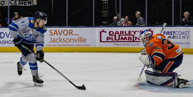 Jacksonville Icemen forward Brendan Warren (41) takes a shot against Worcester Railers goaltender Jakub Skarek (35) during a February 2020 game. [Gary Lloyd McCullough/For the Jacksonville Icemen]