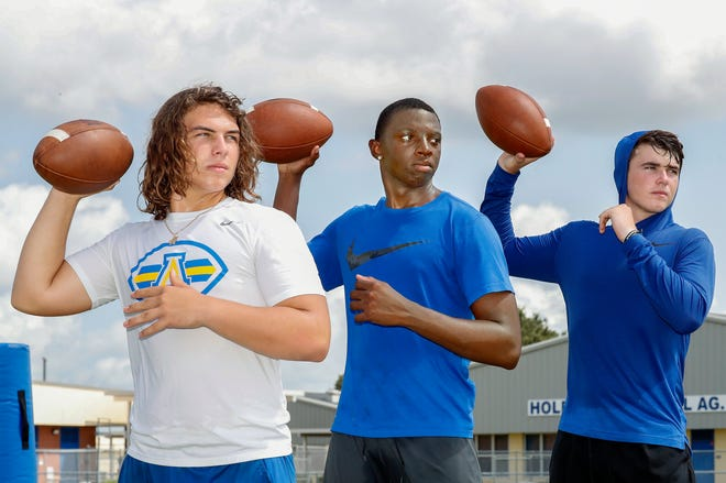 Auburndale  quarterbacks, from left, Cam Sowder, Neil Bryant and Zach Tanner. Auburndale is blessed with three quarterbacks that are starter material.