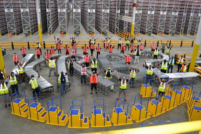 Amazon employees celebrate the opening of a new facility in Prince George County.