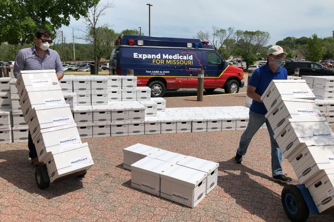 In May, campaign workers deliver boxes of signed petitions to the Missouri secretary of state's office in Jefferson City, Mo. Missouri voters this week approved Medicaid expansion by a 53% to 47% margin.