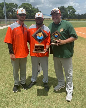 Rich Glass, center, has stepped down as head coach at Palmetto High to take a position on the State College of Florida baseball staff. [photo provided]