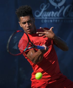Michael Mmoh plays Sebastian Korda (not pictured) during the Elizabeth Moore Sarasota Open at Laurel Oak Country Club in 2018. Mmoh was awarded wild-card invitations to the U.S. Open Championships. [Herald-Tribune staff file photo / Dan Wagner]
