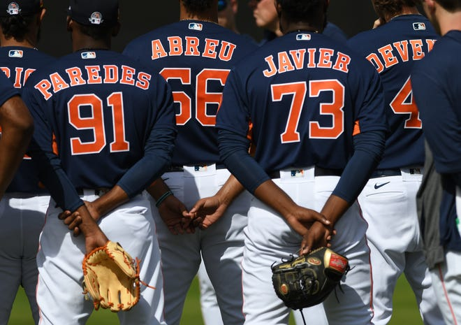 Former Woodpeckers and current Houston Astros pitchers Enoli Paredes, Bryan Abreu and Cristian Javier stand side-by-side during a spring training workout in February in West Palm Beach, Fla. (Jim Rassol/USA TODAY Sports)