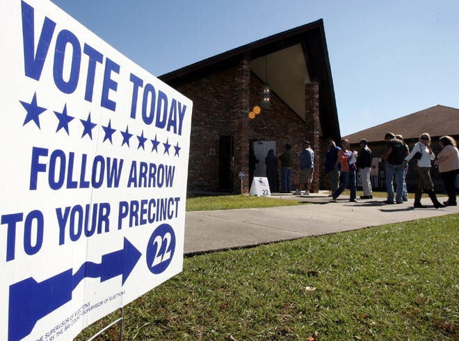 The line to vote is out the door at Emerald Coast Fellowship Baptist Church in Lynn Haven on Nov. 6, 2012.