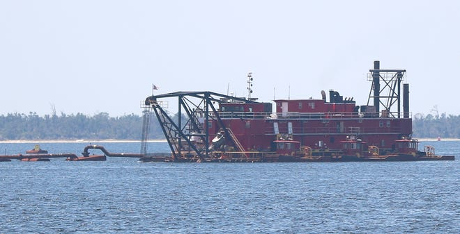 A dredge boat floats on Aug. 6, 2020 in the St. Andrews Bay  near the WestRock Paper Mill. Dredging started on July 3, 2020 and is scheduled to finish in a couple of weeks. [PATTI BLAKE/THE NEWS HERALD]