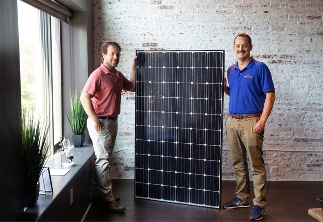 Solar Landscape, an Asbury Park-based company that has been designing, building, installing, and maintaining solar PV systems since 2012. Cory Gross, Founder, COO and Shaun Keegan, Founder, CEO, with a solar panel.  Asbury Park, NJ Thursday, August 06, 2020