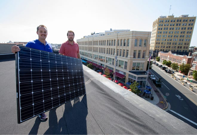 Solar Landscape, an Asbury Park-based company that has been designing, building, installing, and maintaining solar PV systems since 2012. Shaun Keegan, Founder, CEO, and Cory Gross, Founder, COO with a solar panel on the rooftop of their location on Cookman Ave.  Asbury Park, NJ Thursday, August 06, 2020
