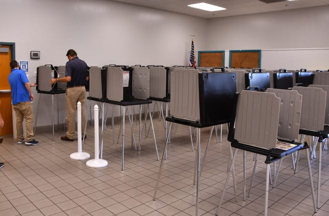 Elections workers on Thursday were setting up more than 30 voting booths at the David R. Schechter Community Center in Satellite Beach in advance of in-person early voting that starts Saturday.