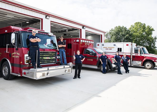Union Township Fire Department employees (L-R) Michael Haughty, Fire Chief Timothy Grimm, Mary Graves, Jami Kness, Alexus Rinehart, and Lt. Tabatha Parks stand in front of the new addition that gives more space for their fire trucks and other lifesaving vehicles and boat.