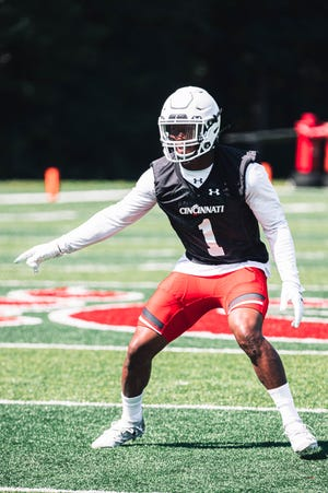 Safety James Wiggins eyes his counterparts as the University of Cincinnati football team started 2020 training camp Wednesday, Aug. 5, at Higher Ground Conference and Retreat Center.