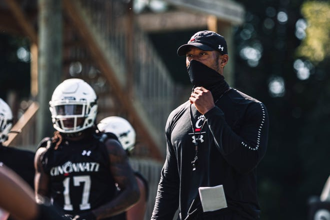 Defensive coordinator Marcus Freeman watches drills as the University of Cincinnati football team started 2020 training camp Wednesday, Aug. 5, at Higher Ground Conference and Retreat Center.