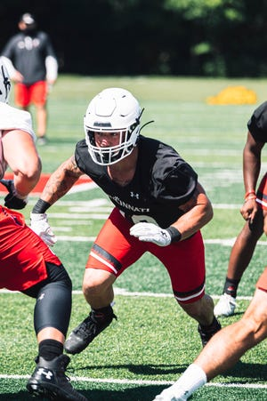 Ethan Tucky eyes his counterpart as the University of Cincinnati football team started 2020 training camp Wednesday, Aug. 5, at Higher Ground Conference and Retreat Center.