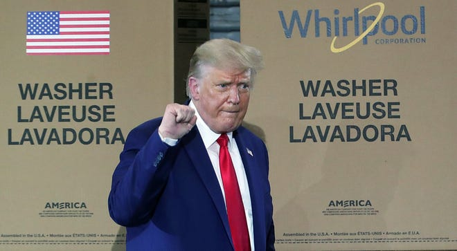 President Donald Trump pumps his fist as he leaves a rally at the Whirlpool Manufacturing Plant, Thursday, Aug. 06, 2020, in Clyde, Ohio. [Jeff Lange/Beacon Journal]