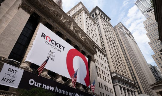 A Rocket Companies sign is displayed outside the New York Stock Exchange on Thursday, August 6, 2020, in New York City.  S