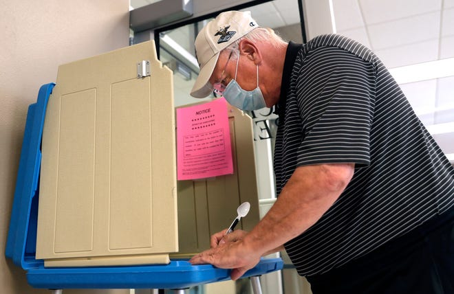Jim Queoff of Green Bay voted Thursday at Green Bay City Hall for the August primary election.