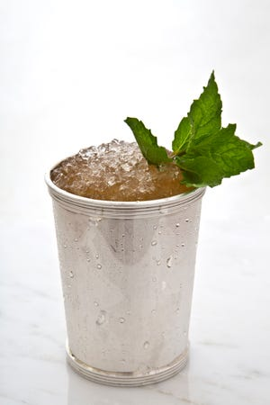 The traditional drink of the Kentucky Derby, the Mint Julep, is a must at any home Derby party.