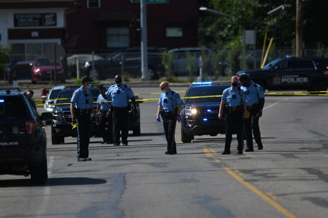 Police search an area near the 1800 block of S. Washington Avenue near Mt. Hope Thursday, Aug. 6, 2020, near where shots were reported. Police said one man was transported to a Lansing area hospital with a gunshot wound to the leg.