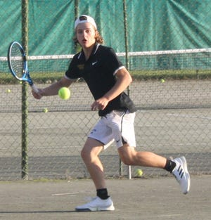 Tommy Secrist chases down a shot that bounces beyond the baseline and goes on to win the boys 16 title in the 87th New Journal/Richland Bank Tennis Tournament at Lakewood Racquet Club