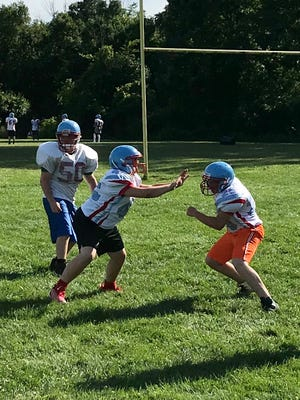 Ridgedale's football team undergoes drills last season during an early practice session.