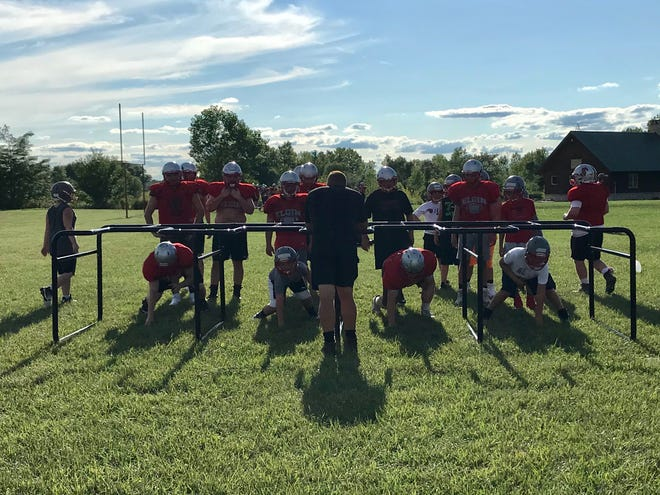 Elgin's football linemen conduct a drill during the first week of practice. Football for this fall was granted a go-ahead by Ohio Gov. Mike DeWine on Tuesday.