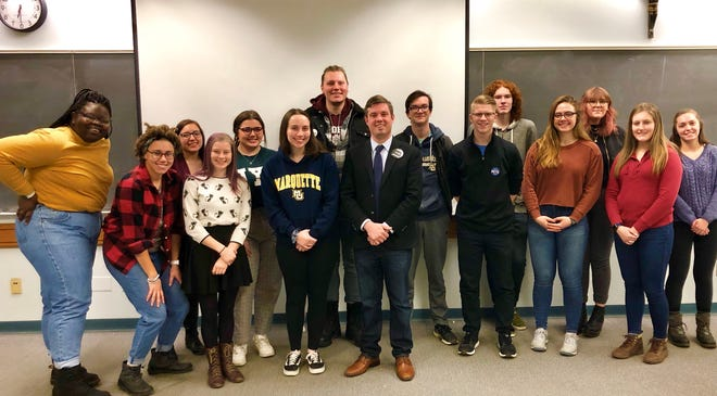 The Marquette University Democrats pose with then-Milwaukee comptroller candidate Alex Brower in a photo taken before the COVID-19 pandemic.