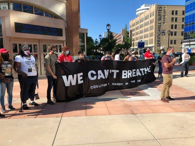 Protesters hold a news conference outside the Wisconsin Center on Thursday. Activists say they still plan on attending the 2020 DNC