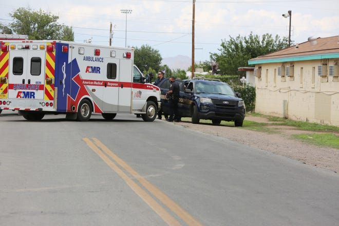 Las Cruces Police, State Police and the Dona Ana County Sheriff's Office respond to a barricaded subject Thursday afternoon on 17th Street near Picacho Avenue.