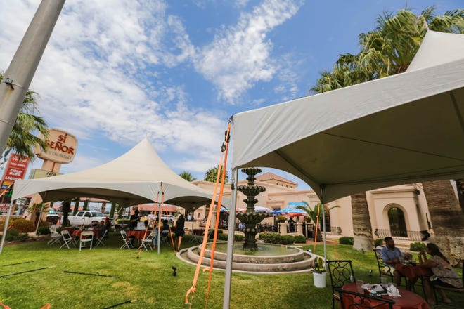 Sí Señor serves customers inside a tent on their property in Las Cruces on Thursday, August 6, 2020.