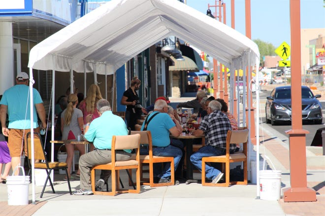 Customers are being served at outdoor seating at TJs Diner at 119 E. Main St., in Farmington, on Aug. 6.