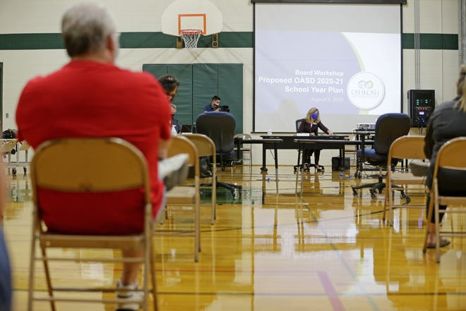 The Oshkosh Area School District holds a school board meeting to decide the plan for the 2020-21 school year on Wednesday, Aug. 5, 2020, at Perry Tipler Middle School.