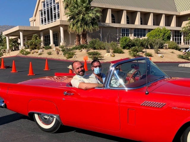 Rev. Andrew Butler (left) and his fiancé, Olly, were driven to the event in a red '57 Thunderbird convertible provided by El Paseo Cruise Night, a group of classic car enthusiasts.