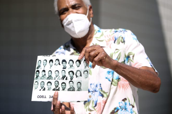 Palm Springs resident Lamar Hoke Jr. holds a photo of himself (fourth from the bottom left) and his classmates from high school on Thursday, August 6, 2020, in Palm Springs, Calif. Hoke, now 78,  was in high school when he heard from his sister, Connie Stanley, after being separated from her following their mother's passing.  Then came decades of searching.