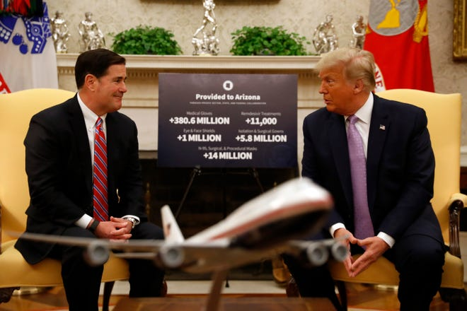 President Donald Trump meets with Arizona Gov. Doug Ducey in the Oval Office of the White House in Washington, D.C., on Aug. 5, 2020.